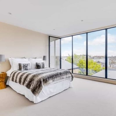 completed loft conversion master bedroom with stairs