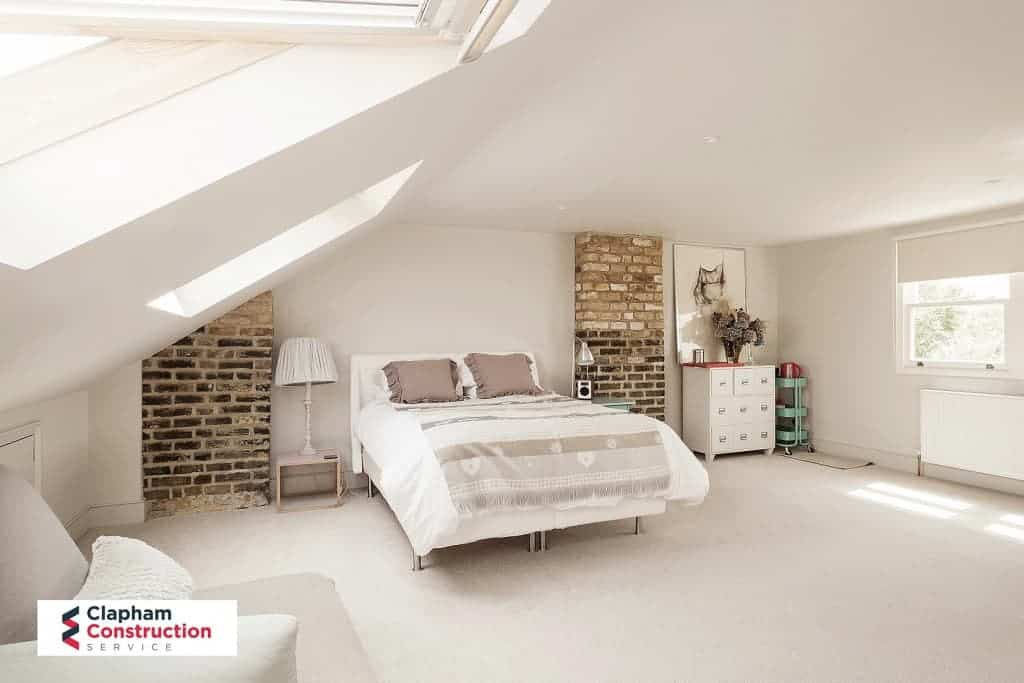 completed loft extension with two visible brick walls - loft conversion inspiration