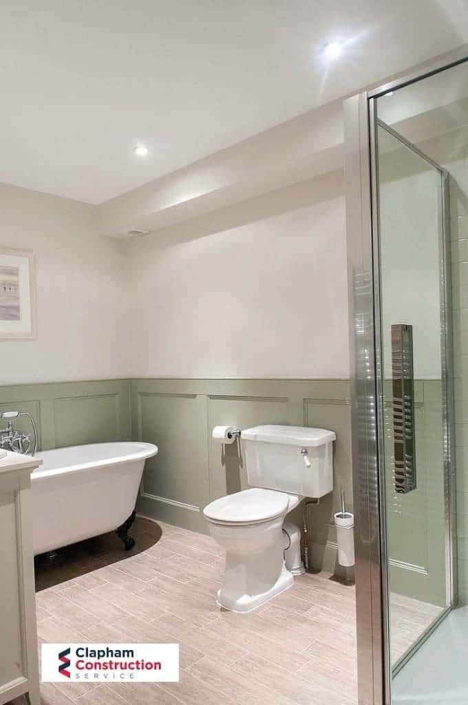 completed loft conversion bathroom with green paint