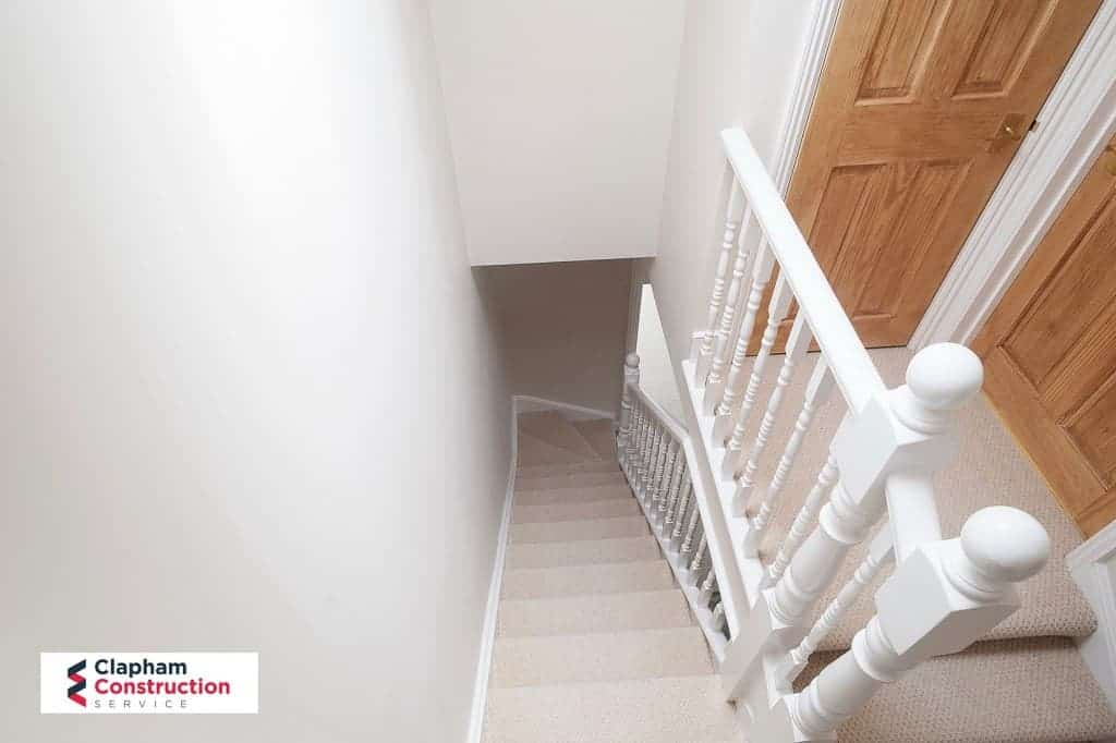 finished loft extension landing showing down stairs
