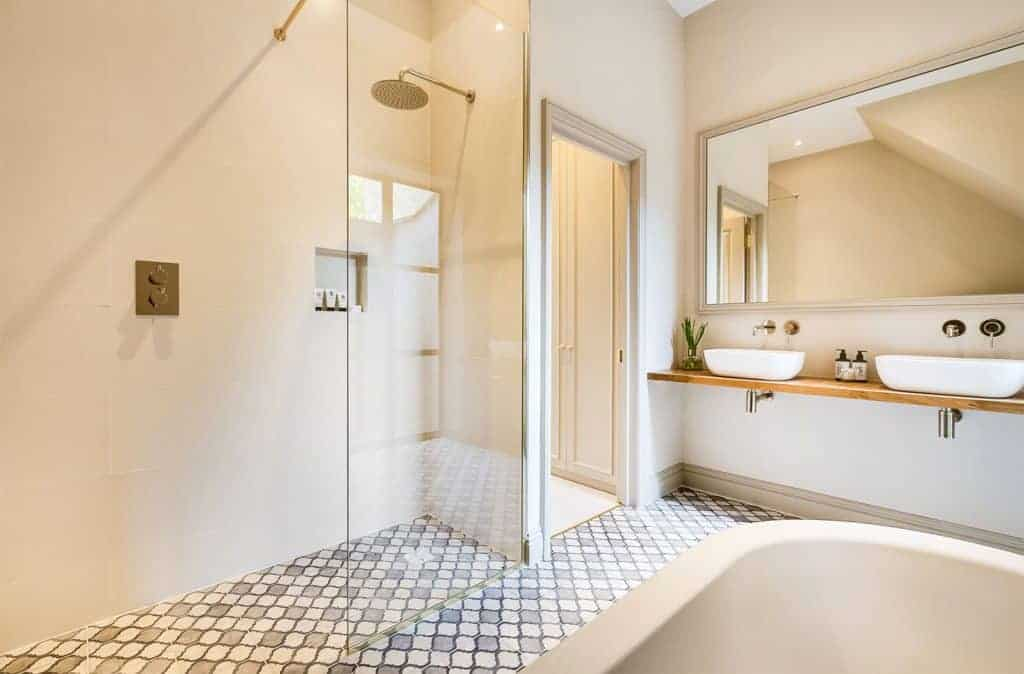 completed loft conversion bathroom with walk in wardrobe