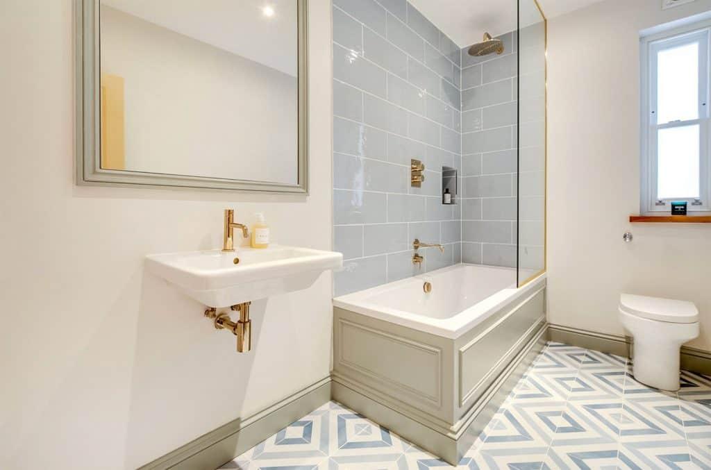 completed loft conversion bathroom light blue tiles