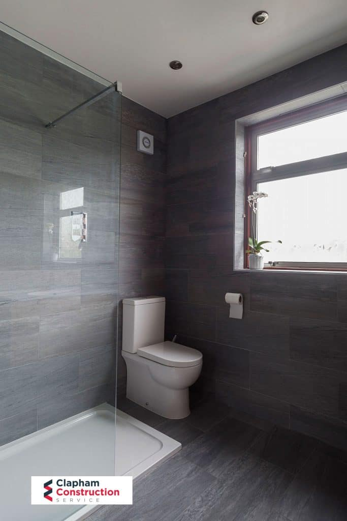 completed loft conversion dark tiled bathroom