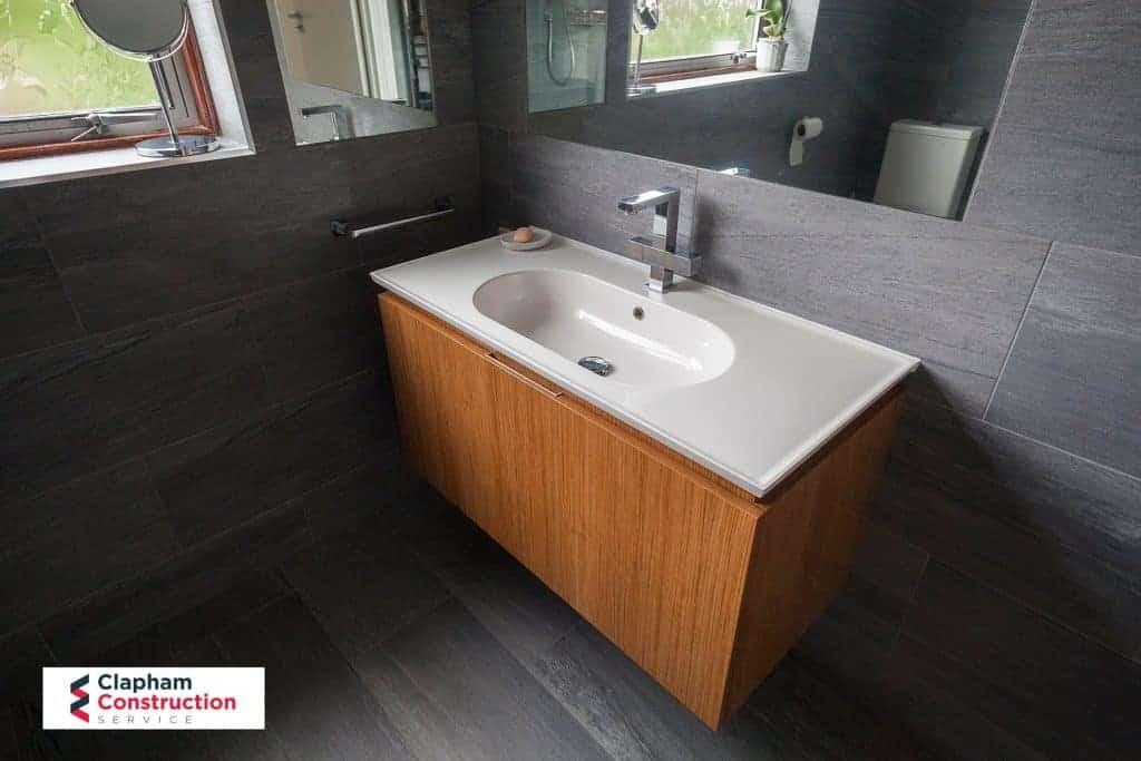 completed home extension dark tiled bathroom oak storage