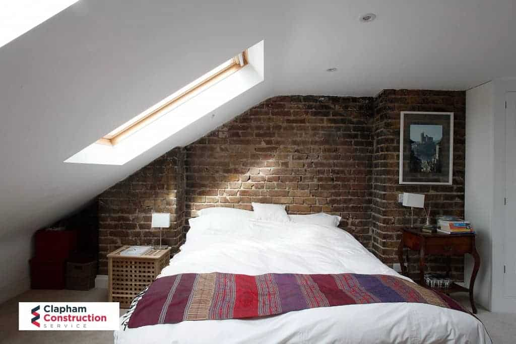 visible brick loft conversion with double bed