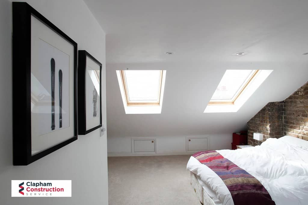 completed loft conversion two skylights and visible brick