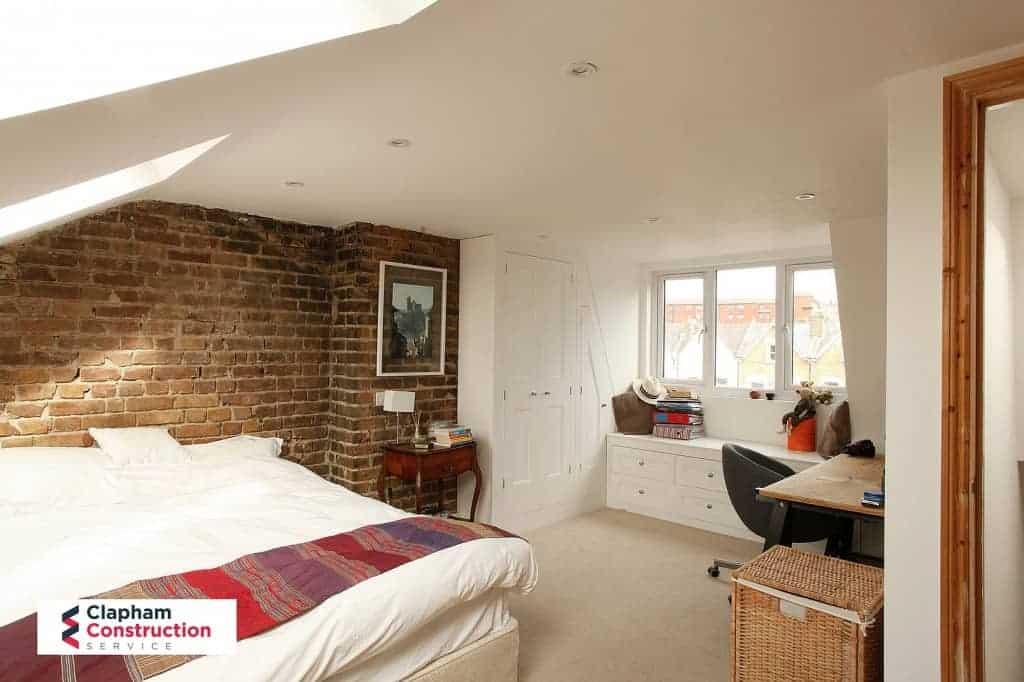 finished loft conversion master bedroom with desk