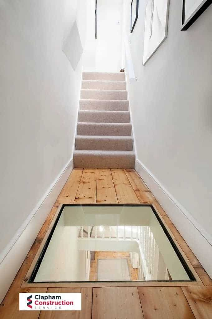completed loft conversion glass in wooden floor