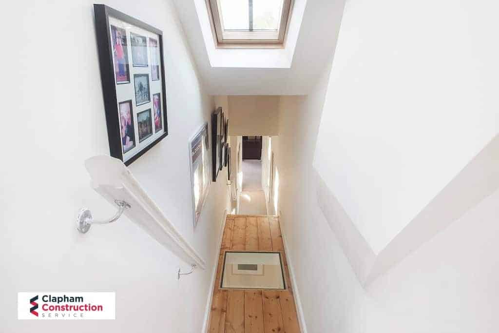 finished loft conversion with stairs and glass hallway floor