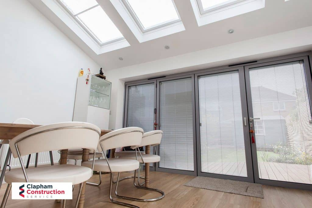 completed home extension grey bi-folding doors