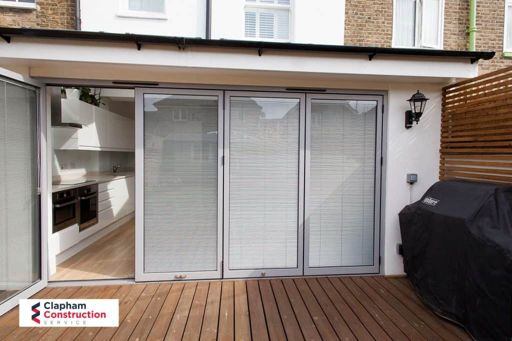 garden view home extension grey bi-folding doors