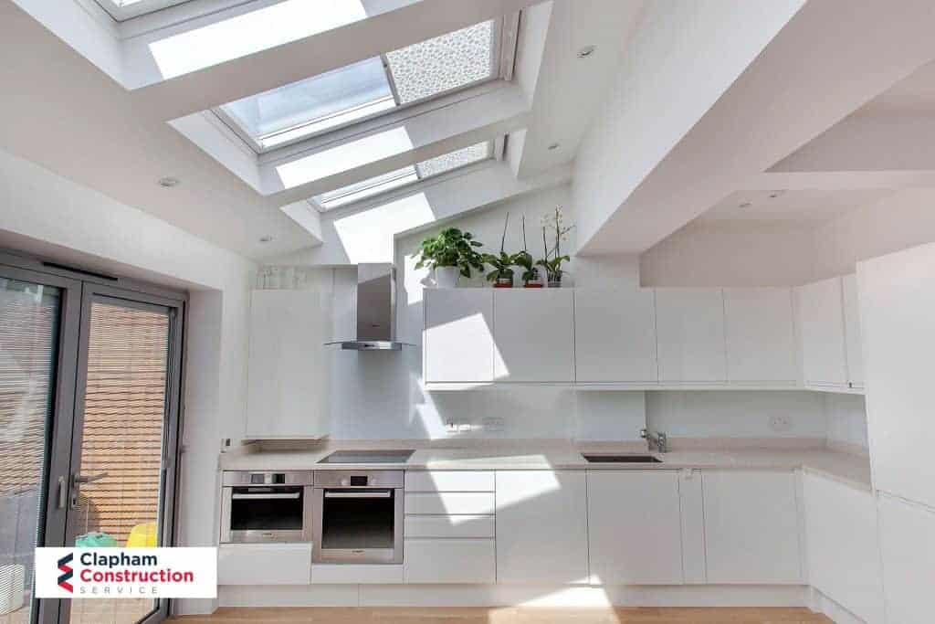 completed home extension kitchen sky light all white