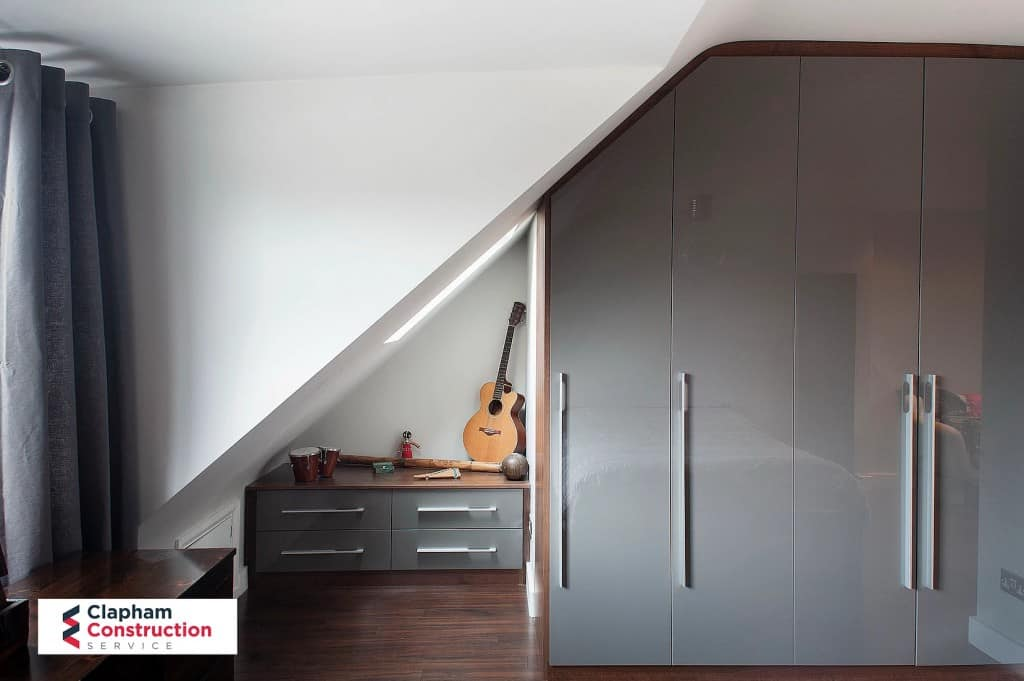 finished loft extension with wardrobes grey doors