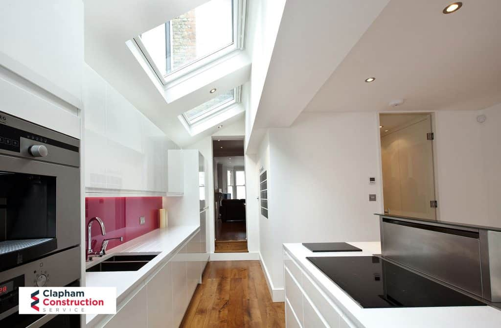 completed home extension red kitchen