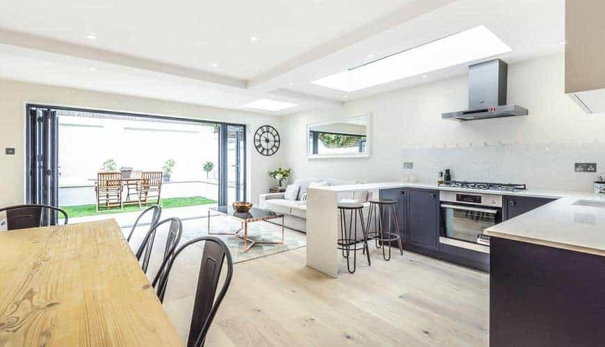 open planned kitchen with bi-folding doors home extension