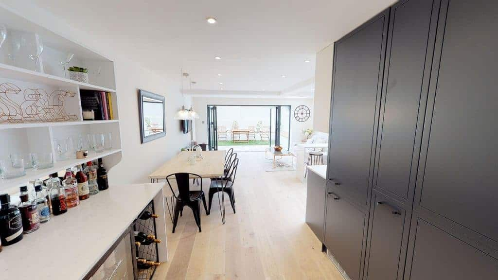 completed home extension bi-folding doors open kitchen diner