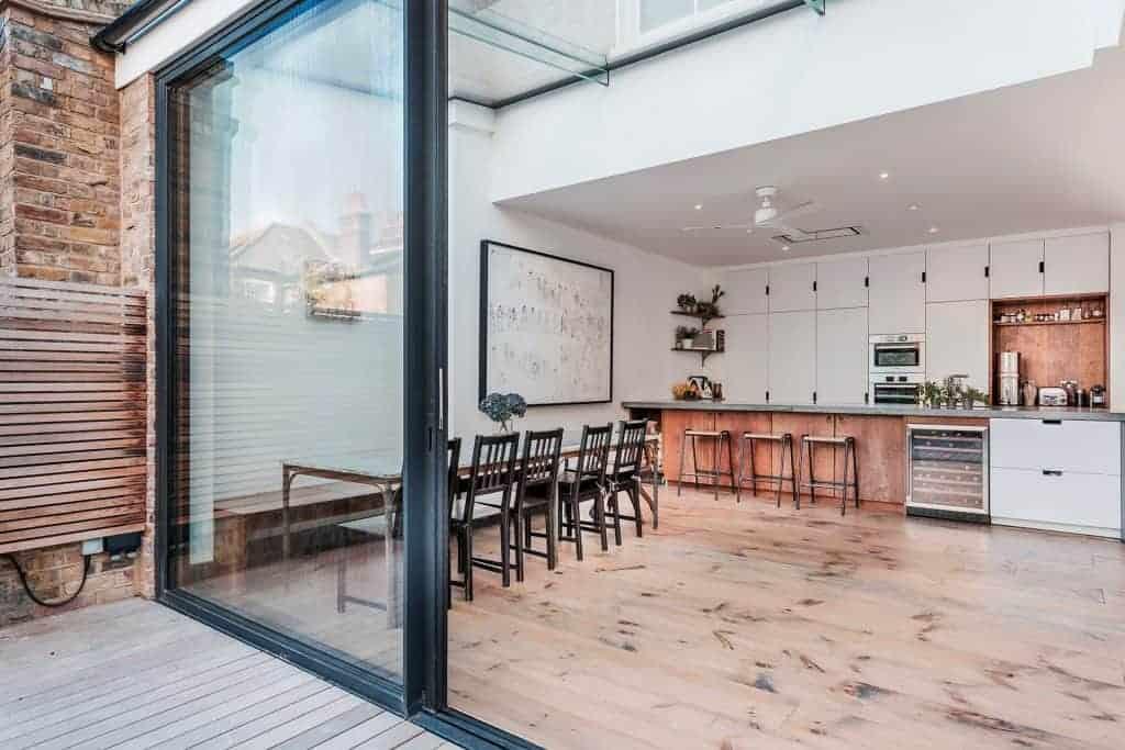 completed home extension open plan kitchen floor to ceiling door