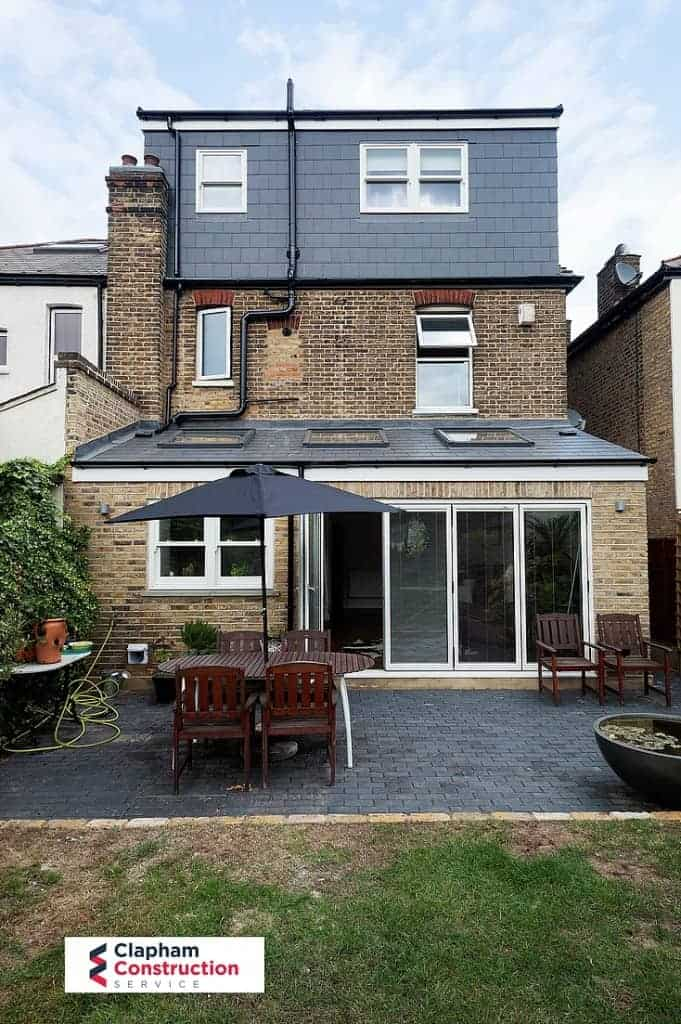 finished home extension with grey patio garden