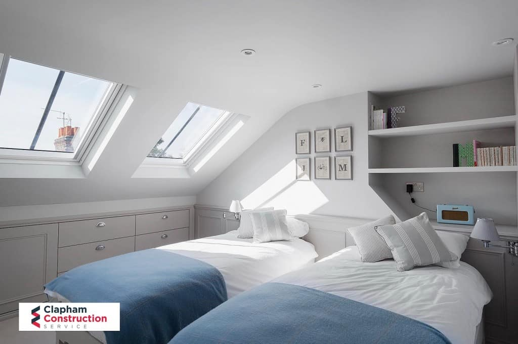 twin bedroom loft conversion with shelves