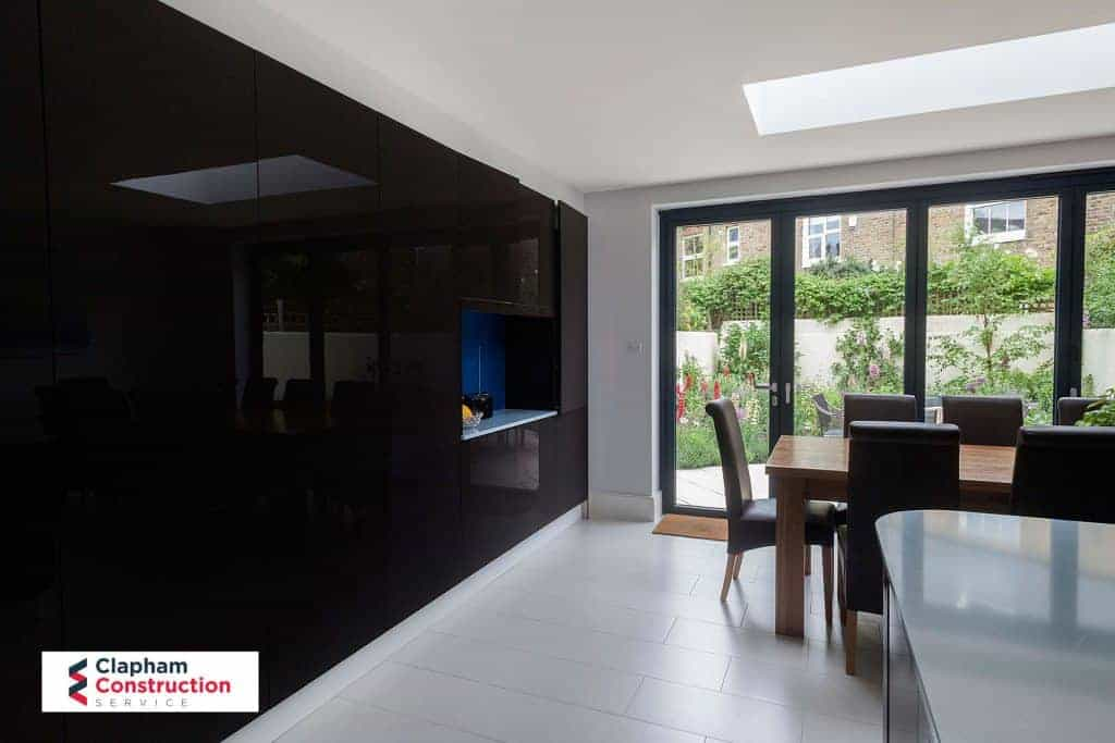 home extension floor to ceiling jet black cupboard
