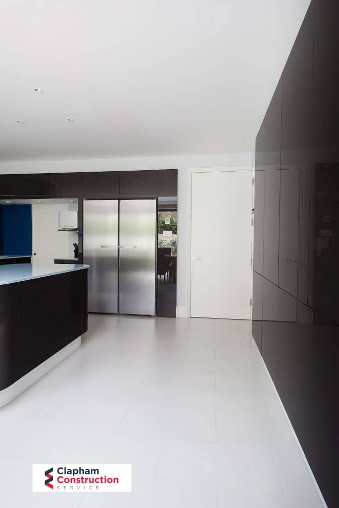 completed home extension floor to ceiling cupboard black kitchen