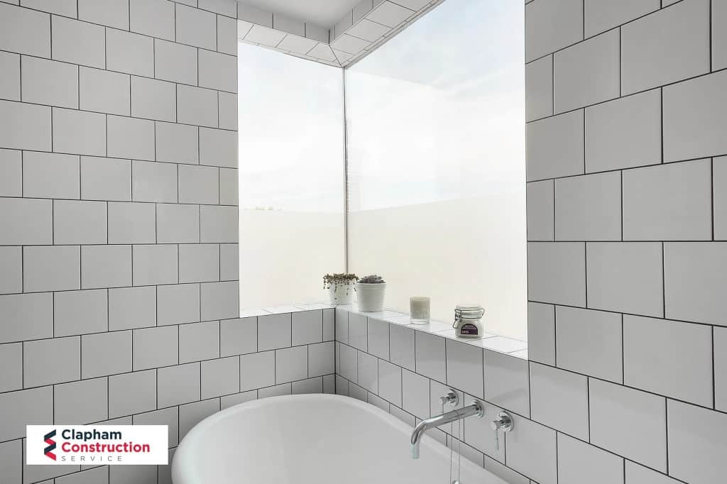 loft conversion bathroom white tiles