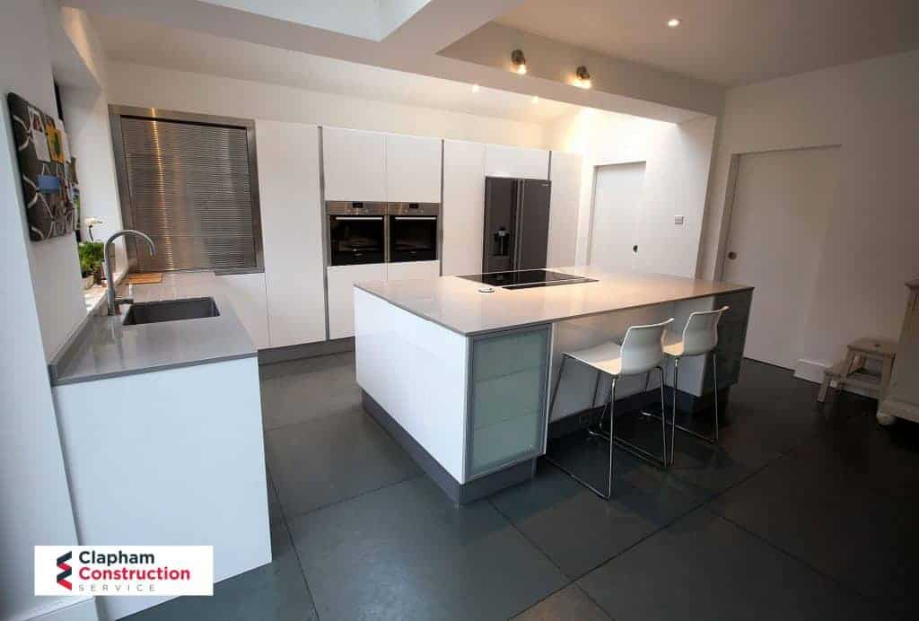 completed home extension black floor kitchen