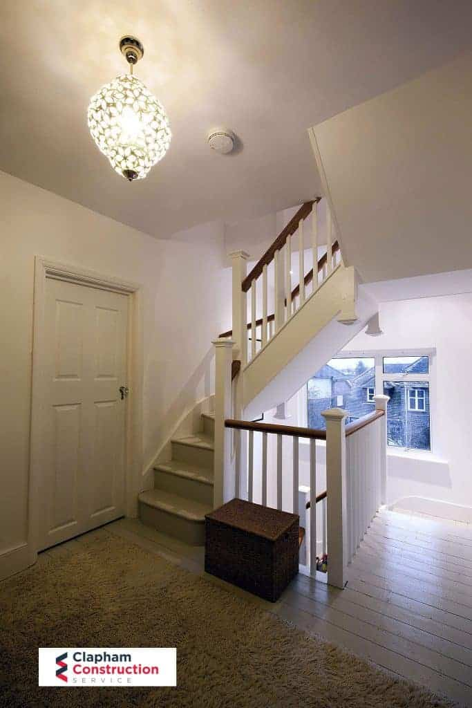 completed loft conversion staircase white and wood