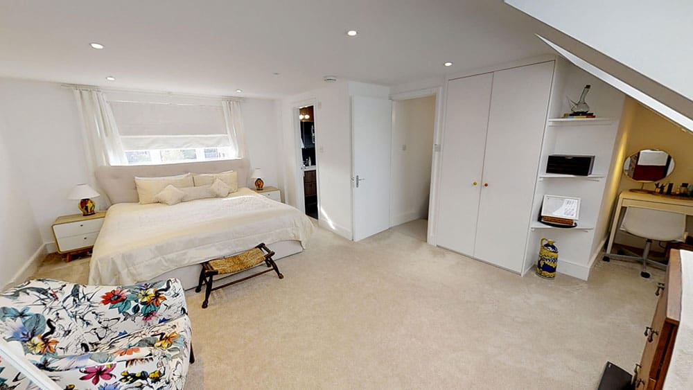 completed loft conversion master bedroom fitted wardrobes