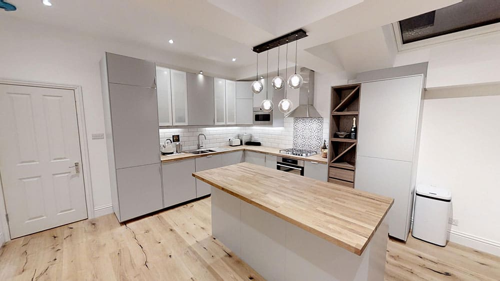 completed loft extension kitchen hanging lights